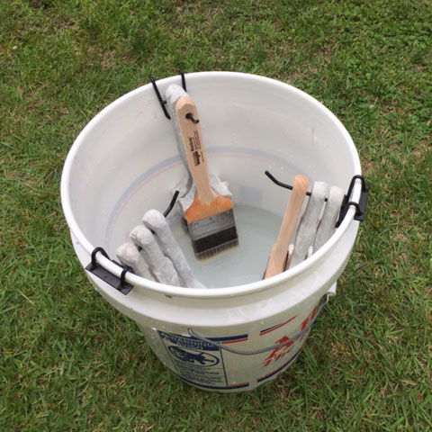 5 gallon bucket with water paint brush hangers